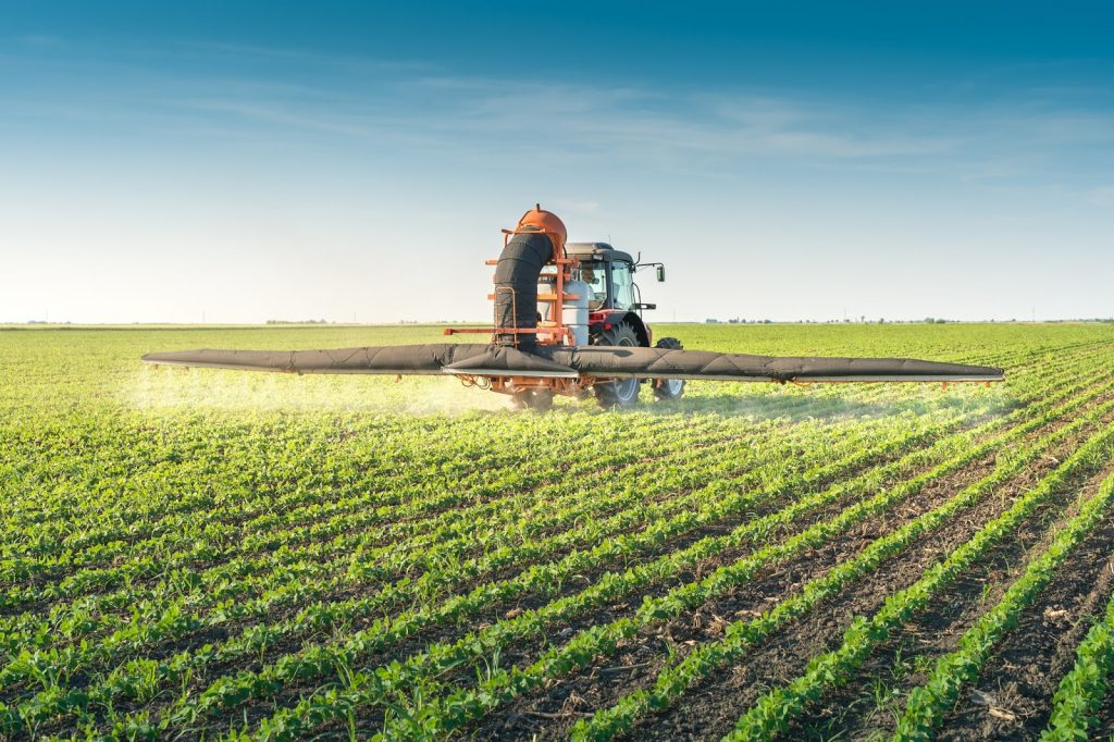 tractor spraying pesticides and herbicides