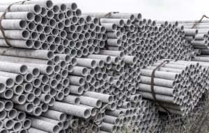 stack of asbestos concrete pipes