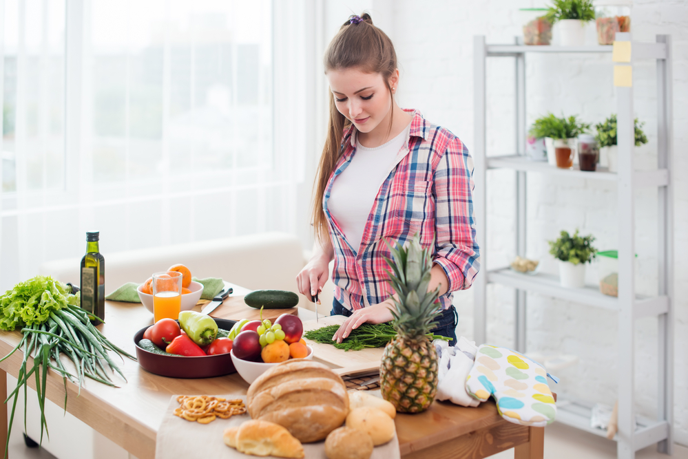 Healty Living - Woman preparing healthy dinner in a kitchen