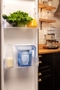 A typical ZeroWater Jug in an open fridge door.