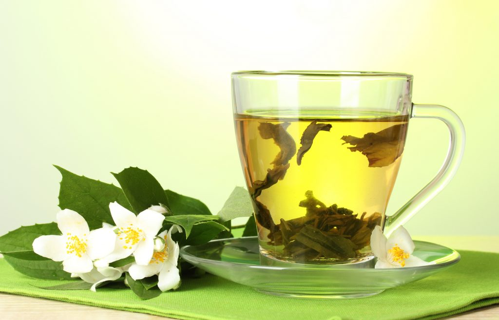 The Health Benefits of Tea, a news article byZeroWater Uk - A cup of green tea with jasmine flowers