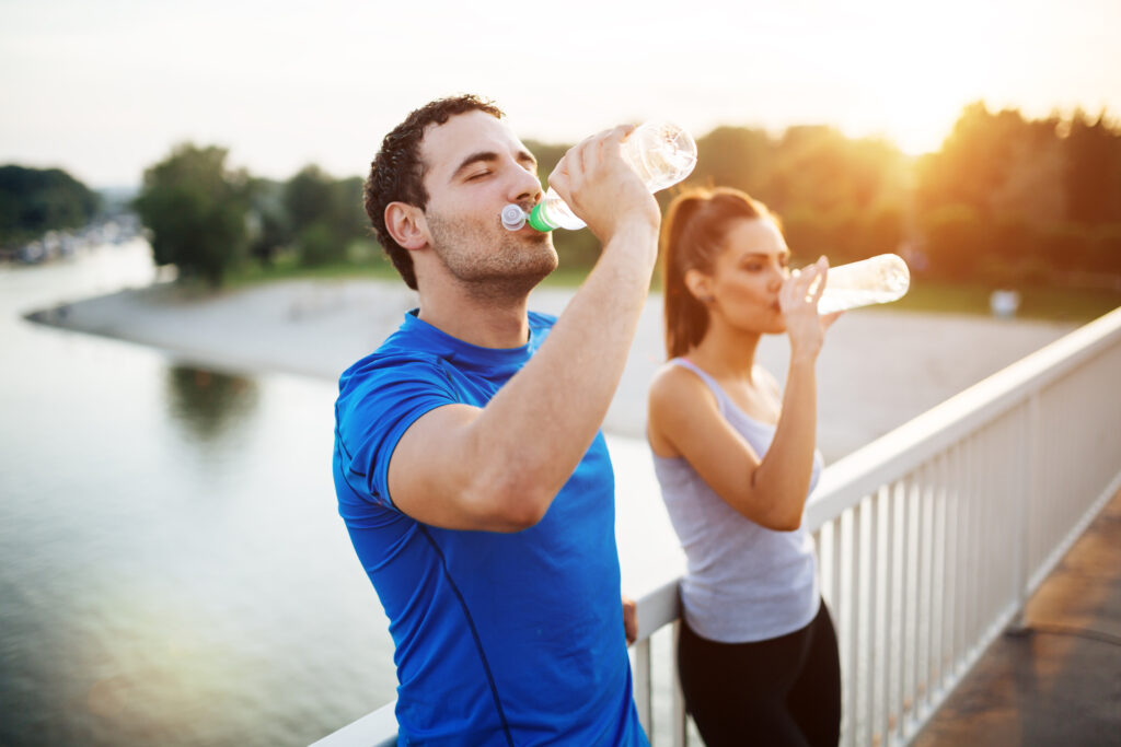 Hydration is Crucial when Exercising Post Lockdown! - Couple staying hydrated after workout