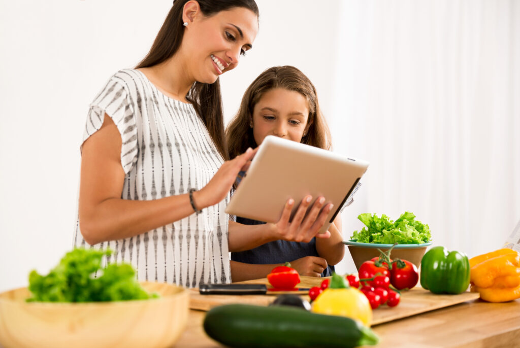 7 Healthy Recipes To Keep You Hydrated This Summer! - Mother and daughter cooking.